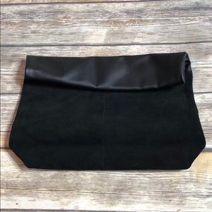Faux leather and suede clutch